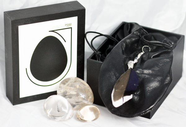 Clear Quartz Yoni Eggs With Black Leather Weightlifting Pouch.